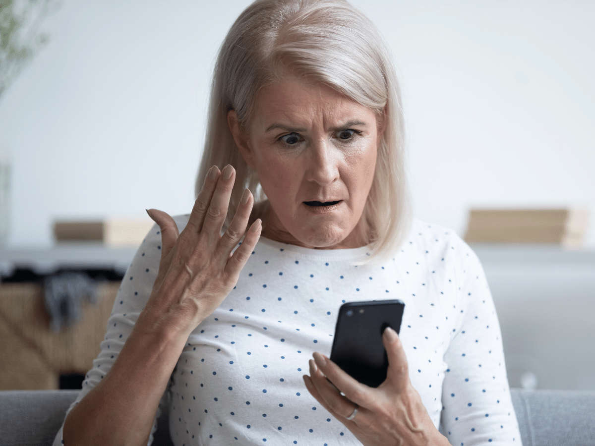 Woman Confused on a Cellphone