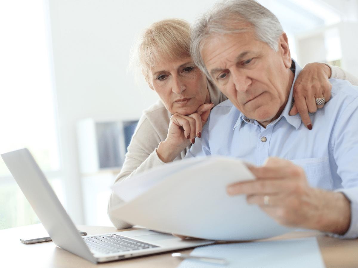 Couple Using Computer Taxes